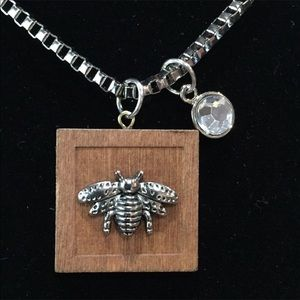 Jewelry - New bee necklace on wood with bling disc